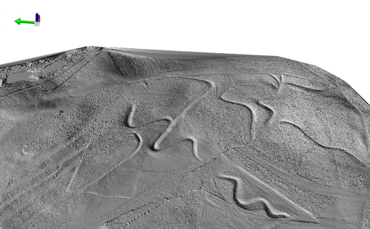 This figure illustrates a hillshade at a 1:10,000 scale derived from the lidar data.  Features of interest such as drainage channels (sinuous features in the figure) are easy to identify and visualize in the hillshade.