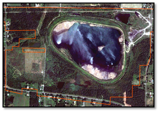 Figure 1. Evaluating high-resolution imagery before a field inspection allows the inspector to identify possible non-compliance issues. This example shows a permit boundary over a WorldView-2 satellite image. In this example, the graphic does not show any potential disturbance outside of the permit boundary (in red), so the inspector would not have to spend extensive time in the field evaluating potential non-compliant disturbance for this site.  Disturbances outside of the permitted area are a violation of State and Federal regulations.