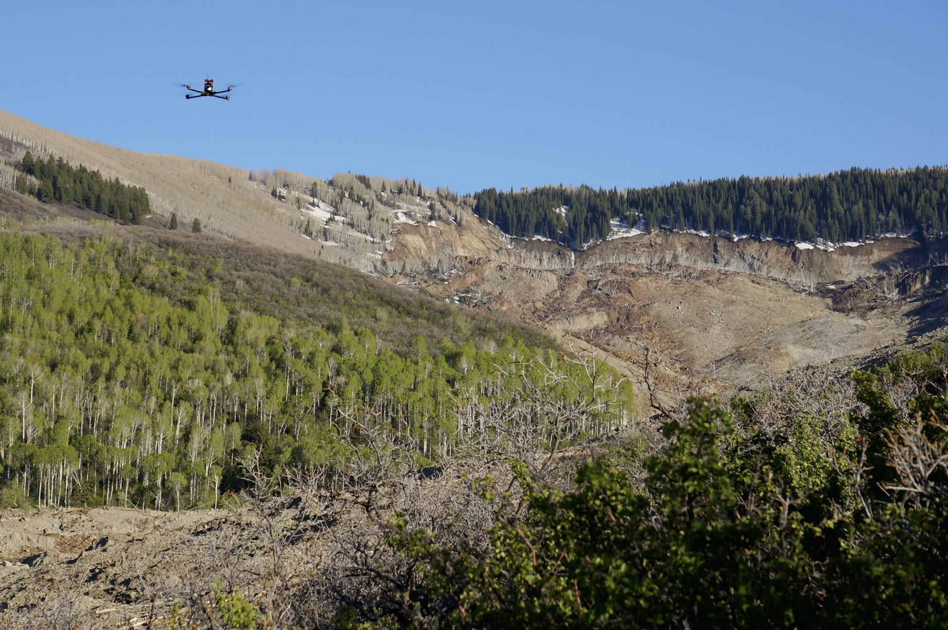 UAS flying over the West Salt Creek landslide on May 26, 2014, one day after the landslide occurred. The view is to the south, looking toward the landslide headscarp. Credit: Sheriff's Office, Mesa County, Colorado.