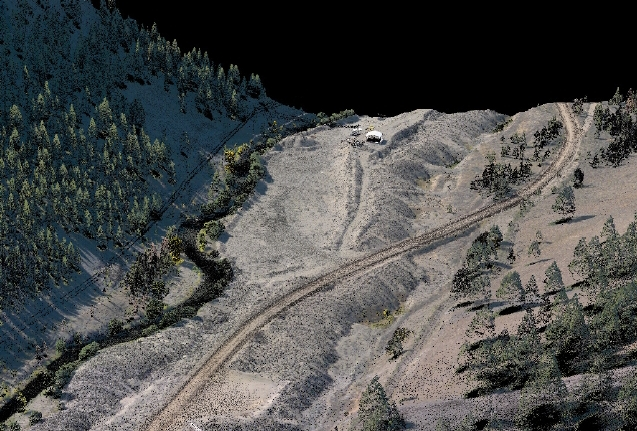 Lidar point cloud along the Yankee Fork River, Idaho showing channelization and spoil mounds resulting from placer gold mining in the 1940s and 1950s.  Colors for lidar point locations are provided by orthoimagery acquired concurrently with the lidar.