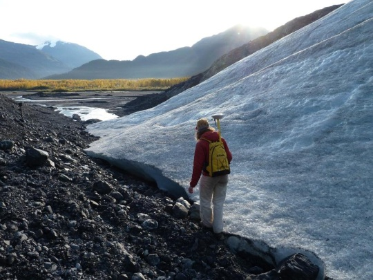 NPS researcher using a GPS to map the terminus of Exit Glacier in Kenai Fjords National Park