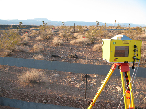 Optech terrestrial lidar scanner overlooking a fenced study plot in the Grand Canyon-Parashant National Monument, Arizona.
