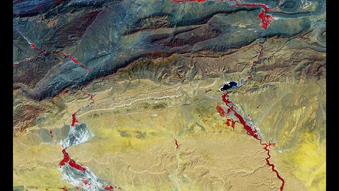 Vegetation appears red in this piece, which moves from dark to light in the Atlas Mountains of Morocco.