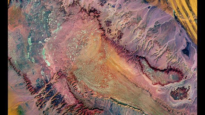 In a remote part of the Western Desert in central Egypt, highly eroded plateaus rise from the desert floor.