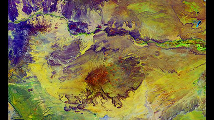 Tranquil colors and patterns intermingle near Argentina's Colorado River, which runs across the upper one-third of the image.