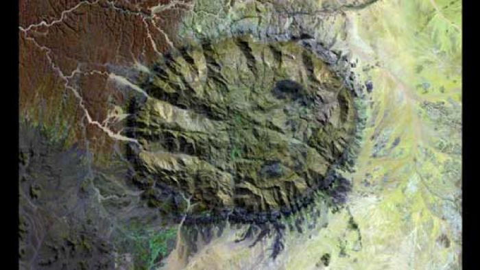 The Brandberg Massif appears as an approximate dark green circle in the middle of the image. It has many grooves and indentations.