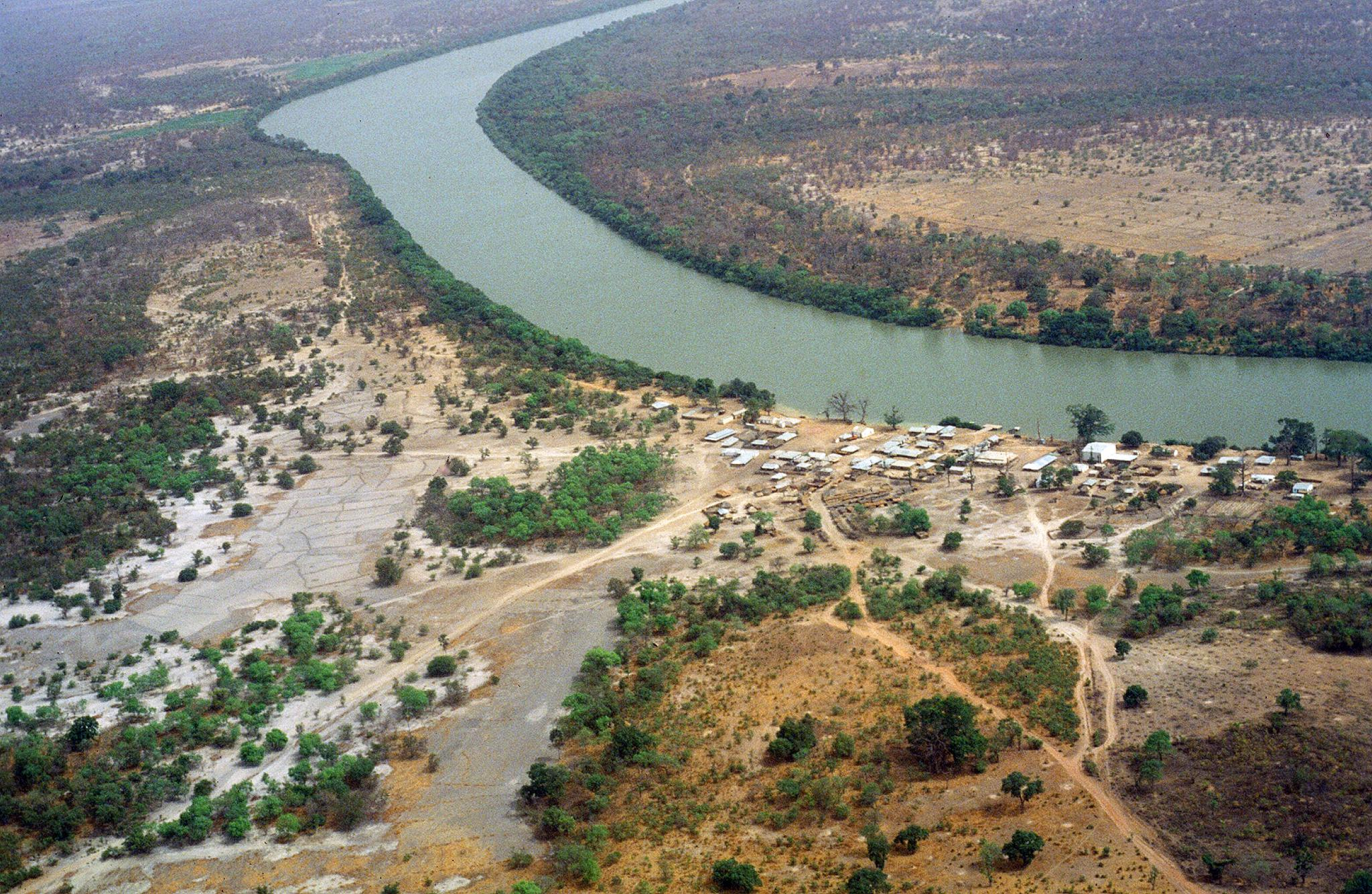 Aerial view of a village on the bank of the upper Gambia River ©Gray Tappan/USGS